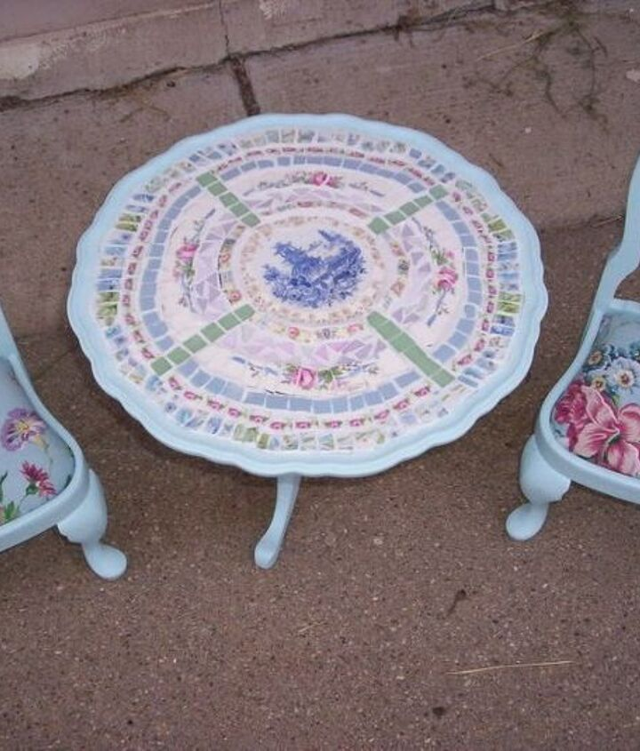 This is a doll table and chair.  I painted it, mosaiced it and covered the chairs with matching fabric.