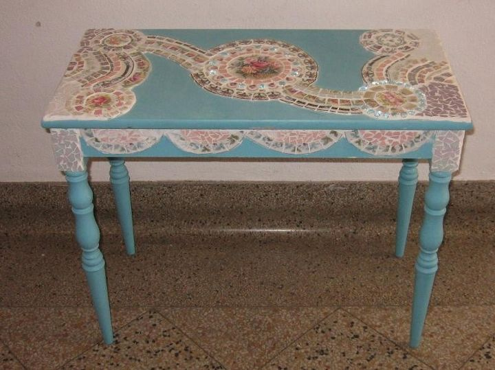 This is a piano bench that I painted and mosaiced.