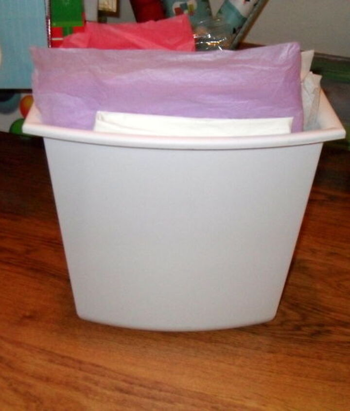 I found 3 of these trash cans that fit perfectly in the top...
