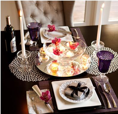 Just Us Two:Whether it's your first or your fiftieth year together, what's sexier than a New Year's Eve dinner for two? Ring in 2013 with a table arrangement that sets the mood. A glass bowl holds floating candles and orchid blooms.