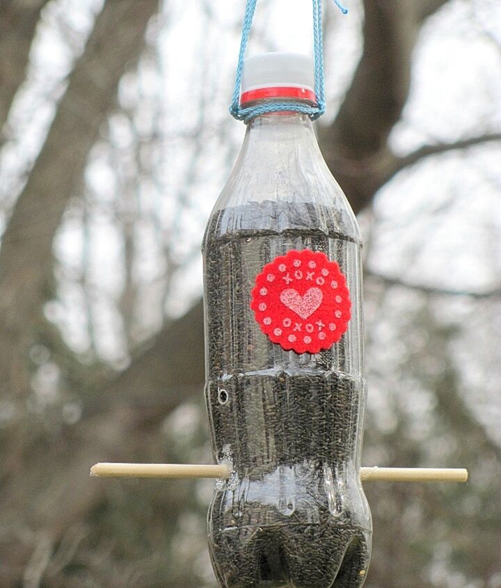 A small Coke bottle turned into a thistle feeder.