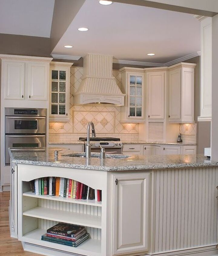 The oil rubbed bronze knobs provide a welcomed visual break from the cream tones in the cabinets and the tile, while the twisted wire style also toned down the modern feel of the stainless steel appliances.