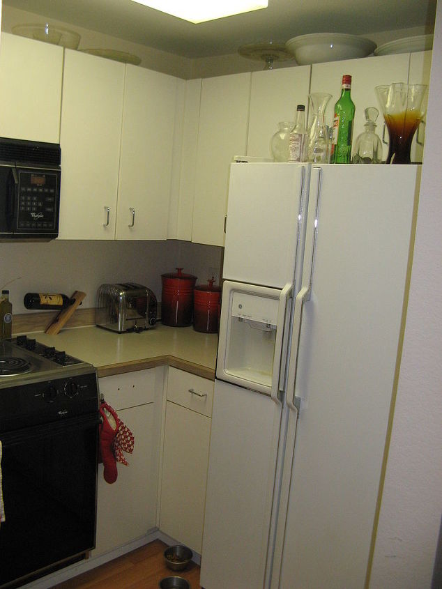 blind cabinets in the corners were useless.  Anything put in there for storing was never to be seen again if it rested in the back.  This kitchen had only 1 drawer before the remodel