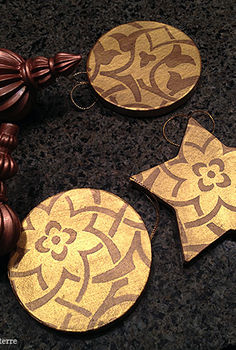 stenciled christmas tree ornaments, christmas decorations, crafts, seasonal holiday decor, It s so easy Paint a base coat of color and then stencil away with a different color on your ornaments Here I used gold and bronze metallic paints