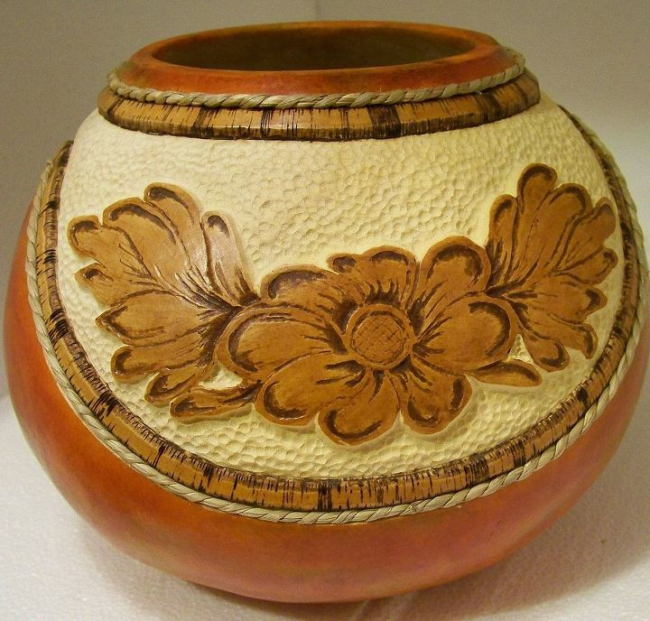 carved tooled leather look with rope rim.