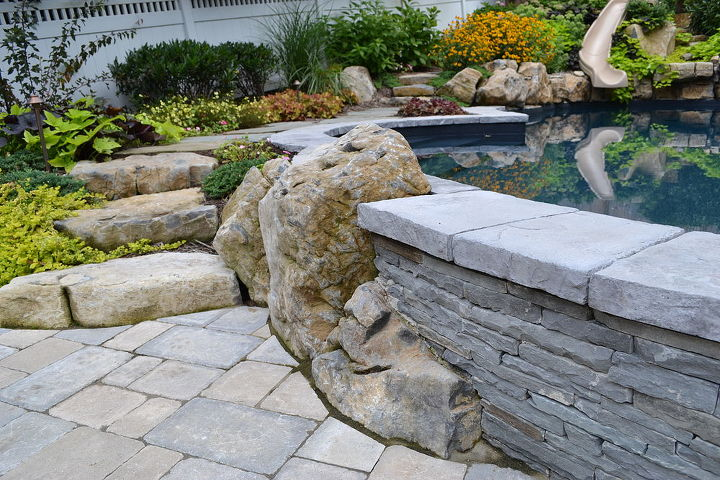 Boulders, stacked bluestone and Unilock pavers