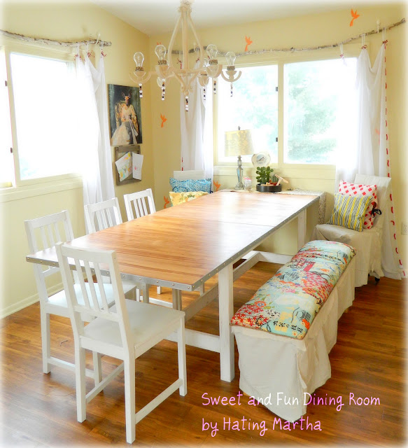 This room had the table refreshed, chairs painted, the bench upholstered, walls were stenciled, the chandy was completely redone, and...lots of fun was added! A plain IKEA table was given a faux metal edge!