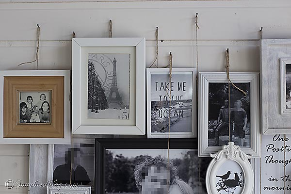 All the frames are hung with a string of twine.