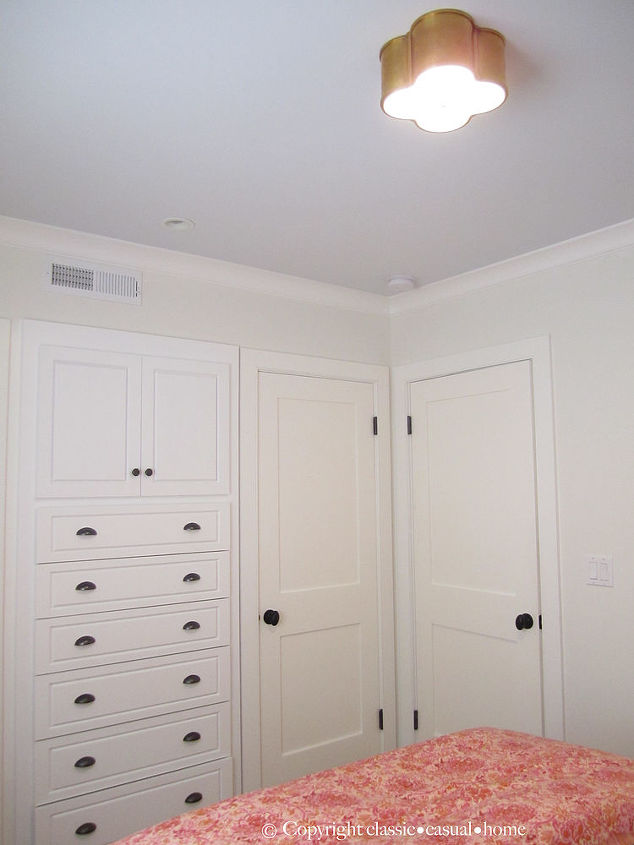 You can see the closet next to the built-ins here.  It all works. More here... http://www.classiccasualhome.com/2011/09/daughters-room-updates.html