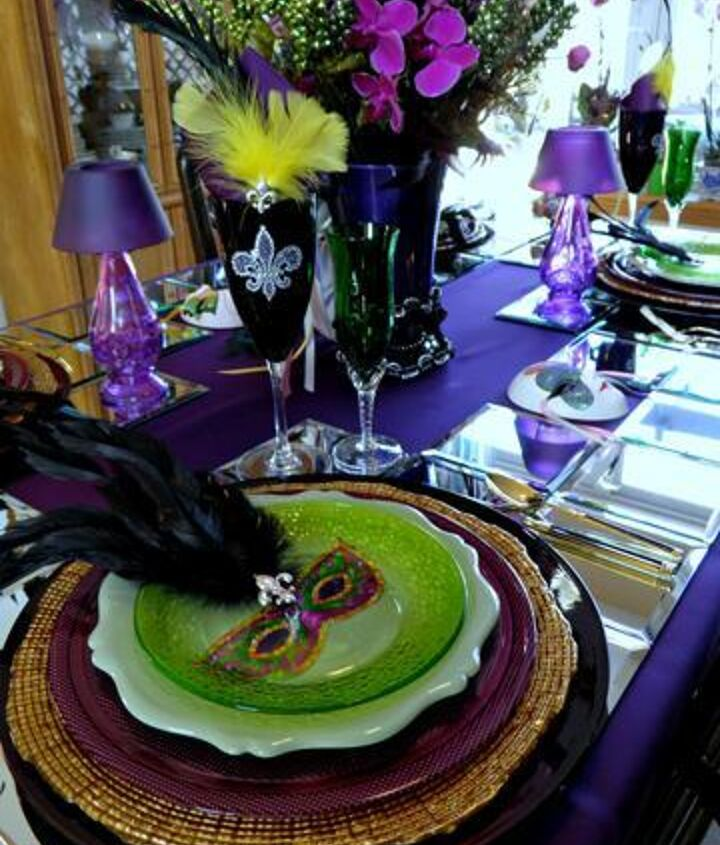 Mardi Gras table setting using masks cut out from paper plates and feather embellishments.