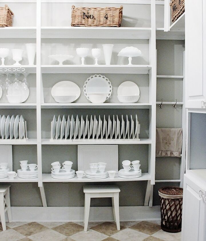 Open shelving with white dishes and platters.  Ready for company.