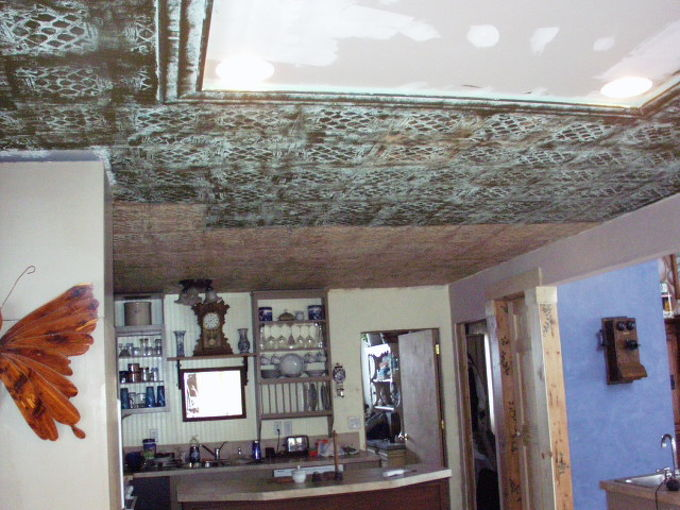 tin ceiling tile look for almost free with plaster and paint, diy, paint colors, painting, walls ceilings, After the plaster dries it s time to paint This part is really fun I was going for an antique copper look on my ceiling