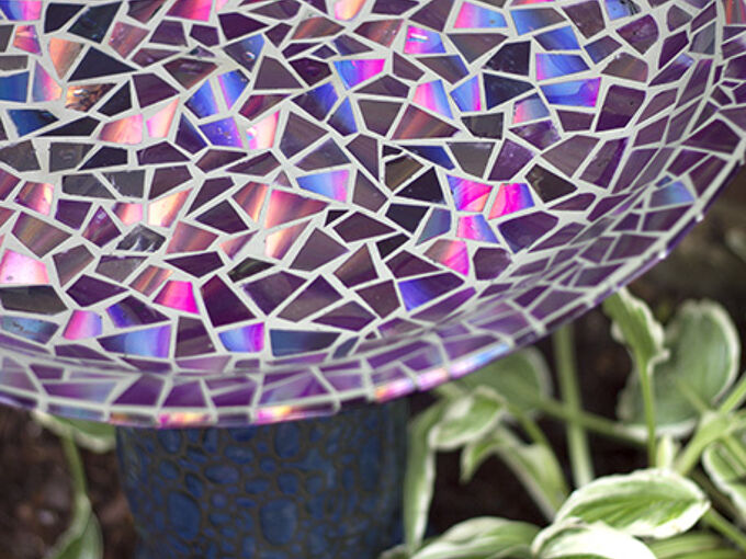 mosaic tile birdbath using recycled dvds, crafts, gardening, repurposing upcycling, Even with no experience in mosaics or tiling our bird bath face lift turned out just as I had hoped Now I m thinking about all the other things I could do gazing balls garden stakes water fountains etc The sky s the limit
