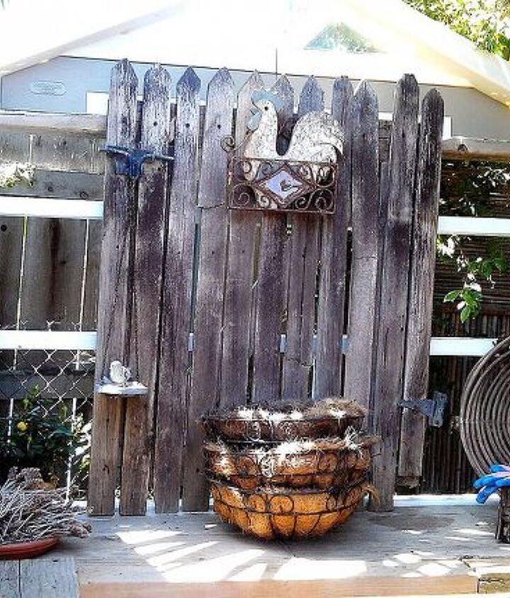This used to be a gate to the yard to my tack room which had seen better days.  Now it gives character and vertical interest to the table.