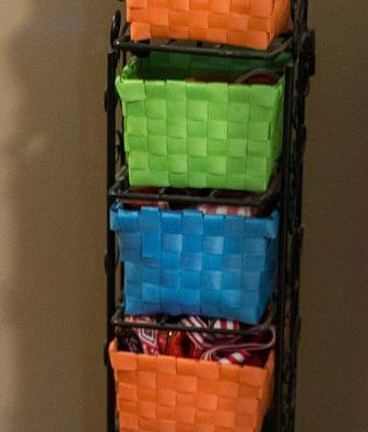 I used a cd rack (yard sale for $1) and bought baskets at the dollar store to store even more ribbon.