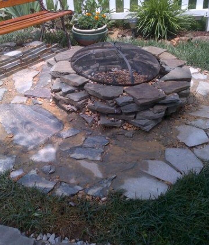 Finished fire pit sitting area. I added ready mix concrete and it's looks pretty good just needs to dry. Can you see the broken pieces of marvel table?
