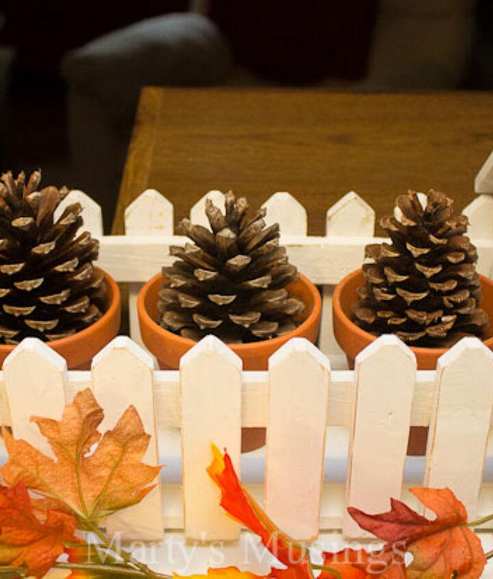 Pine cones in mini clay pots
