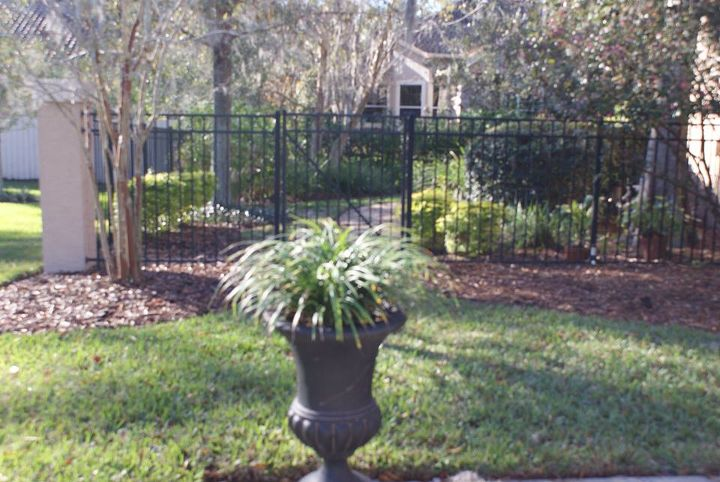 A simple liriope in an urn at the end of the driveway is a hardy strong statement.
