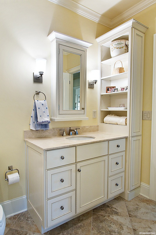 """Taking details to the bathroom.  Do you think this mirror/medicine cabinet would be a quaint w/o crown molding and a basic bottom ledge?   This is a custom medicine cabinet... looking grand with an """"inset"""" mirrored door.   Also note the custom linen cabinet with side access ... with flush baseboard :)"""