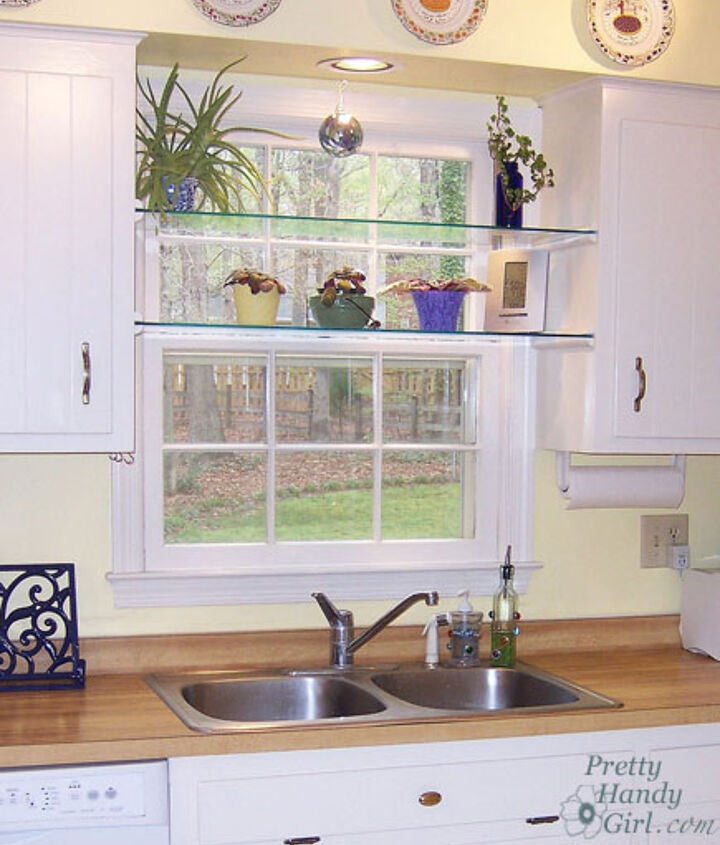 See through glass window shelves allow light in and give you a spot to set your plants.