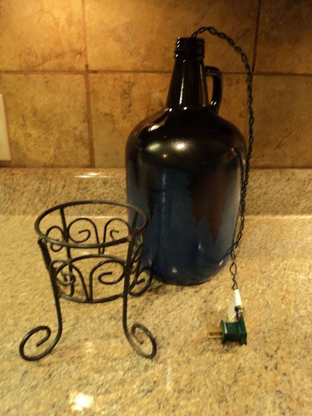 starry night light, christmas decorations, crafts, lighting, seasonal holiday decor, 5 Put the lights into the bottle leaving the plug and enough length of the electrical cord to plug into outlet