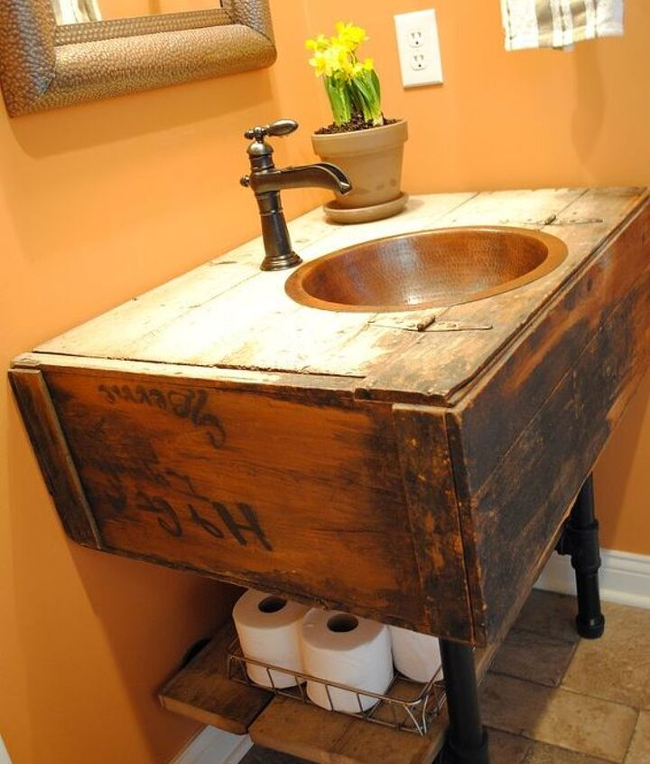 We attached it to the wall with the plumbing flanges and hooked up our plumbing lines.  I added some barnwood pieces to act as a storage shelf, resting on top of the pipe.