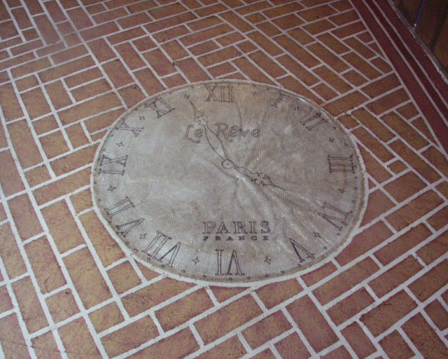 This clock face came out of a magazine (not too much of that on the Internet yet when I did this floor)  It's traced onto the concrete.
