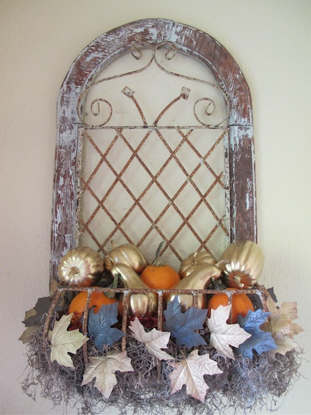 In the entry nook...I spray painted dollar store gourds & a pack of leaves & mixed them with sugar baby pumpkins.