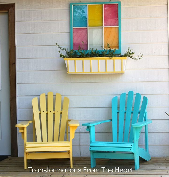 Adirondack chairs with window box planter and old window frame.