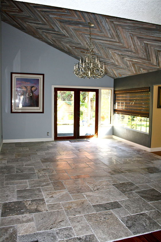 Flooring is silver travertine in a Versaille pattern. Yes, I did that myself as well!