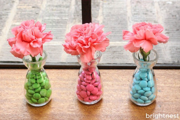 Centerpiece jars. To make a unique table centerpiece or mantle display, all you need are a few cool jars. Fill the jars with different colored candy (use the same type for a cohesive vibe) and arrange them artfully along your tabletop.