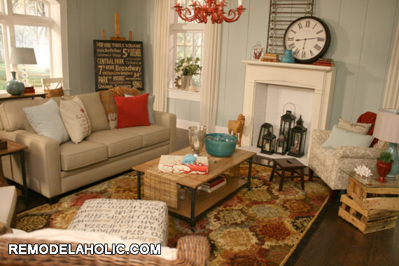 We used the Shaw rug as inspiration!  And pulled the pops of red and blue from it to give the room a collected feel.