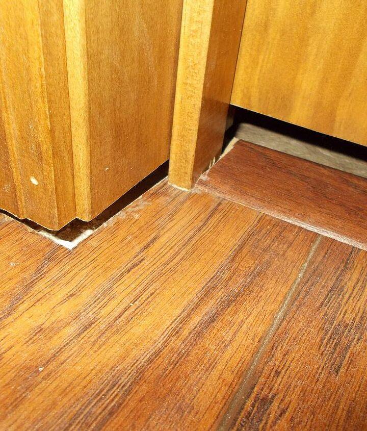 gaps where frame doesn't cover new flooring.