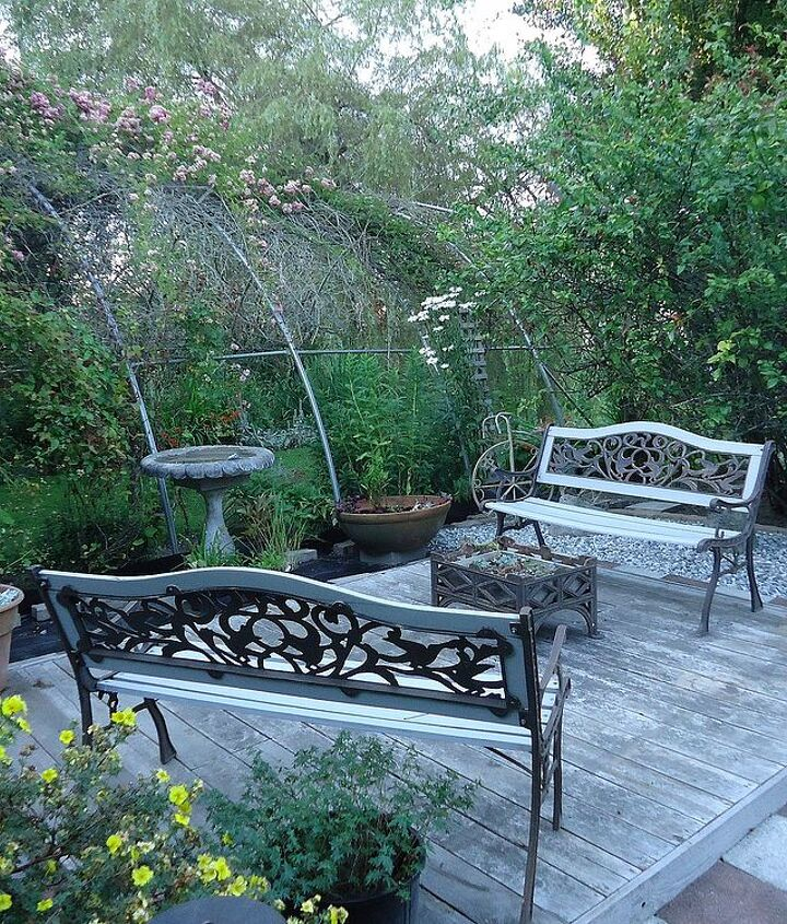 Okay, away went the bench and table. Out came two old benches that we had forgotten about. I love the wrought iron. Added a living wrought iron planter as a living table.