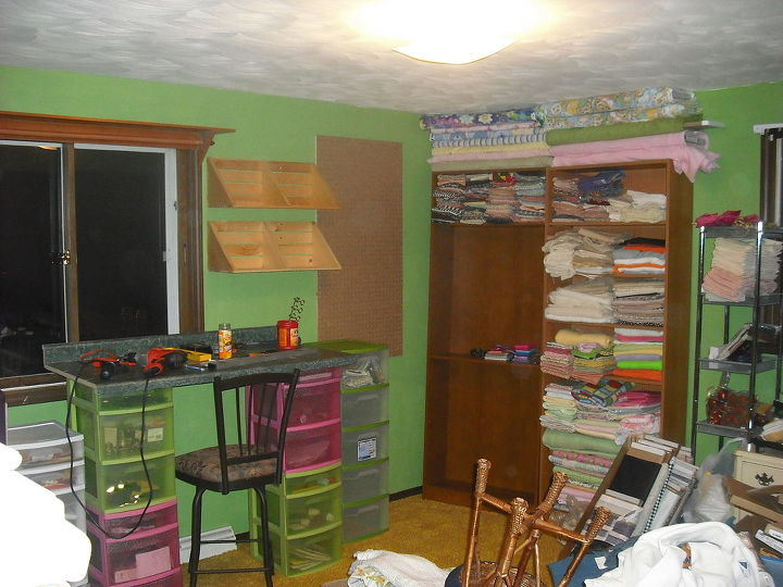 You can see I hung my peg board to hold rulers, hammers, etc., went and bought a new swivel high chair.......started to fill the book shelves with all the material