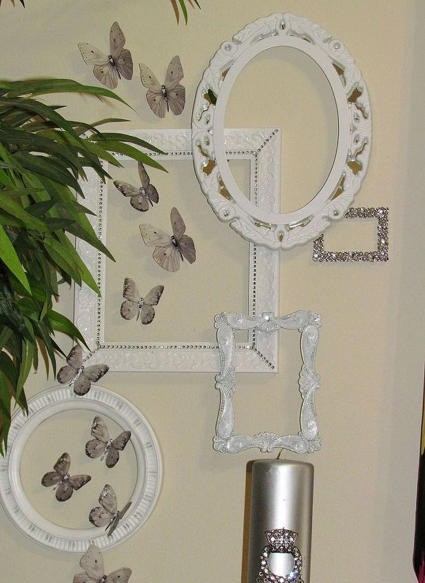 These frames I purchased a while back. Painted, added embellishments. Stacked and positioned on floor first. Attached with tiny nails and glue gun. They  are very light weight