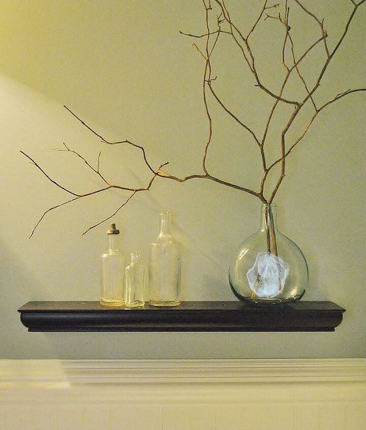 Antique bottles and branches from the backyard add to the nature-themed accessories to the room