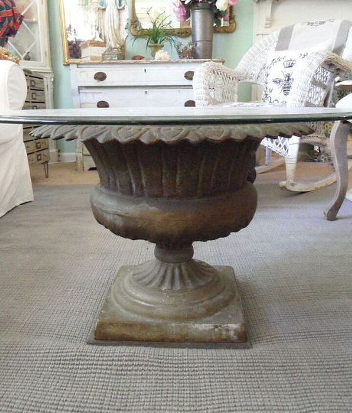 Simply find an antique cast-iron urn and top it with glass.