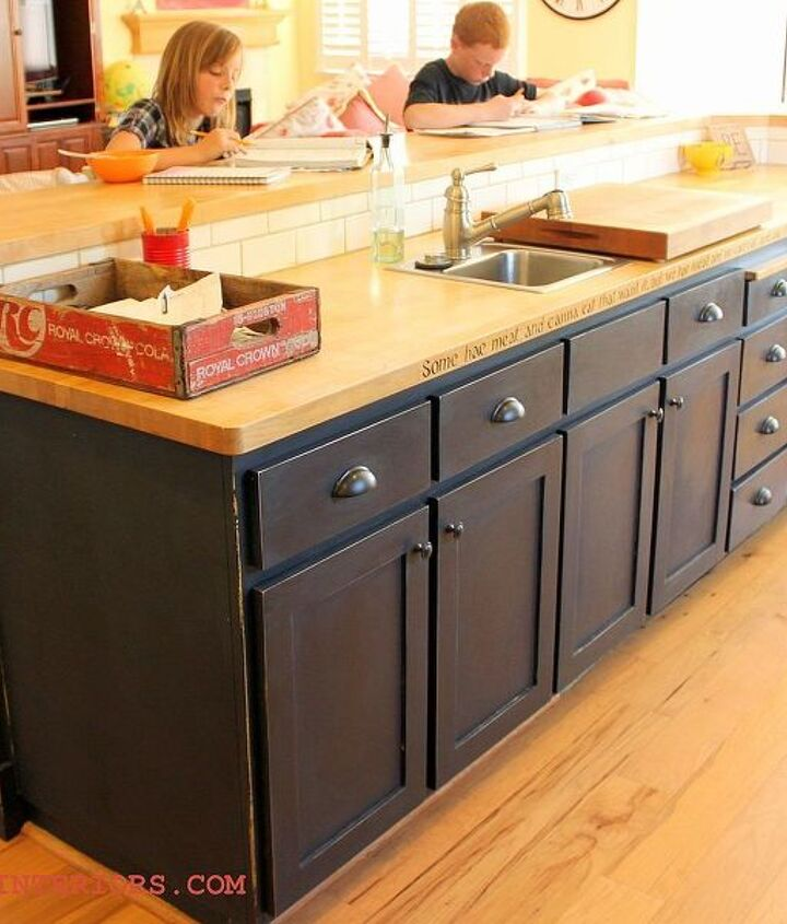 Black island painted in chalk paint and hand waxed gives this builder grade island a truly custom built look.