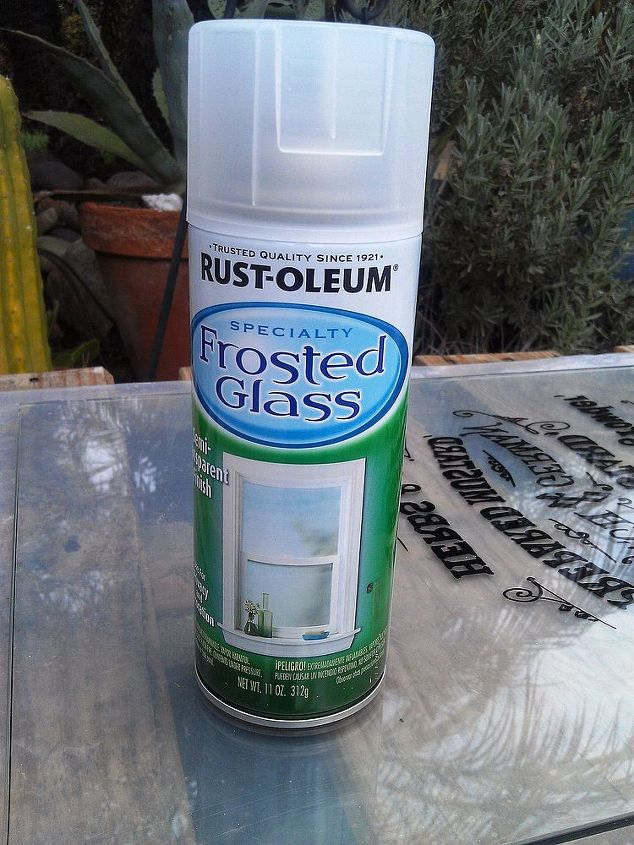 After the painted graphics dried, I then frosted the backside of the glass with Rustoleum's Frosted Glass spray.  I used 3  coats, letting each coat dry before beginning the next.