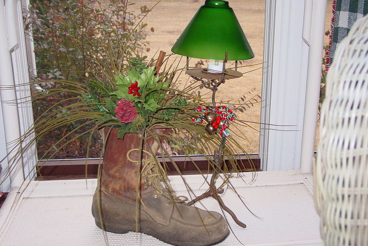 just had to share this before i change out the christmas theme to something wintery, repurposing upcycling, seasonal holiday d cor, My Dad s yard shoe is one of my favorite treasures I use it year round on my back porch and change the florals each season He passed away 5 years ago and every time I look at it I can see him enjoying his yardwork