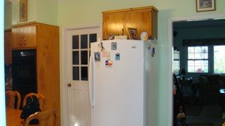 q i currently have a u shaped kitchen and would much prefer a galley, kitchen design, my kitchen opening to living room door goes to utility room washer dryer then out to one car garage