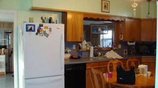 q i currently have a u shaped kitchen and would much prefer a galley, kitchen design, my kitchen thru the window to my sunroom craft area