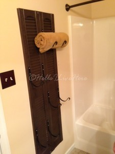The Finished DIY Shutter Towel Rack by Hello I Live Here hung onto wall - guest bath.