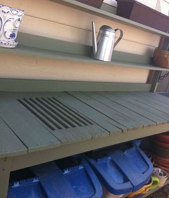 I just love the two shelves above for storage as well as the taller shelf below.Mr. B, as you know, makes some pretty good quality shelves!I have two lidded containers below, one for potting soil and one for my homemade compost.