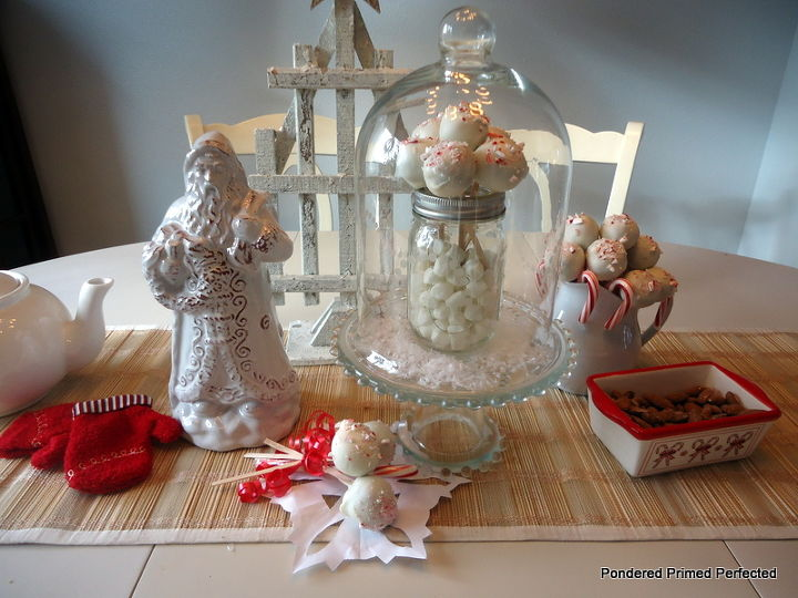 our holiday party prep with hometalk and wayfair, christmas decorations, seasonal holiday decor, The dining table holds treats and decorations to layered together My Christmas Cake Pops take center stage inside the Wayfair Cloche and Cake Plate