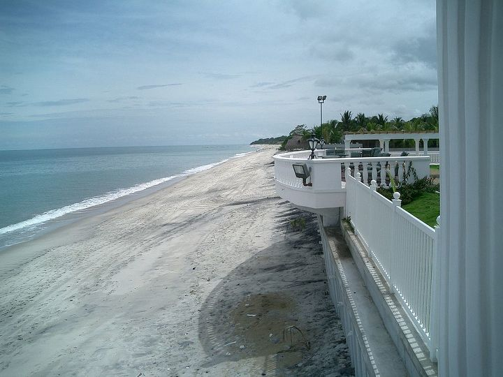 beach with sea wall. The land was elevated 10 feet to give better views and for the house to be higher than the neighbors house