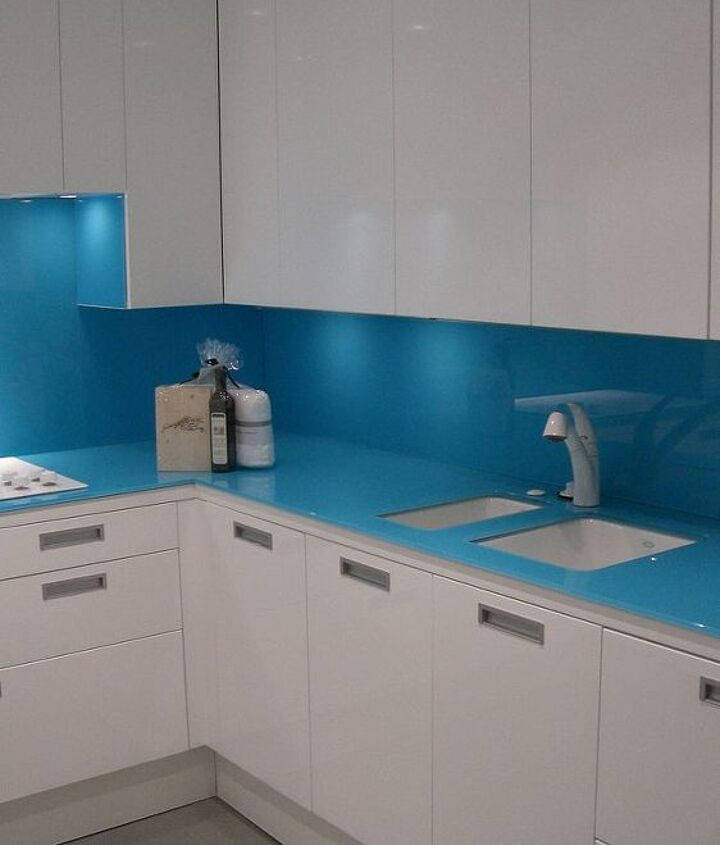 the cabinet above the sink hides a disy drying rack that keeps things off the counter.