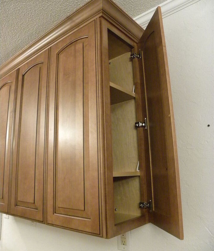 """Secret"" door to upper cabinets. Easy access from the bar seating."