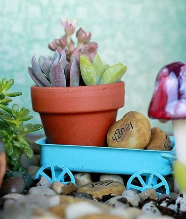Tiny details! An impossible small clay pot holds cuttings. It rests inside a blue wagon that was once a Christmas ornament! #AugustGarden